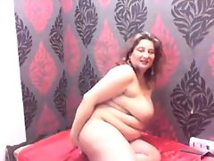 Big woman gets naked and poses